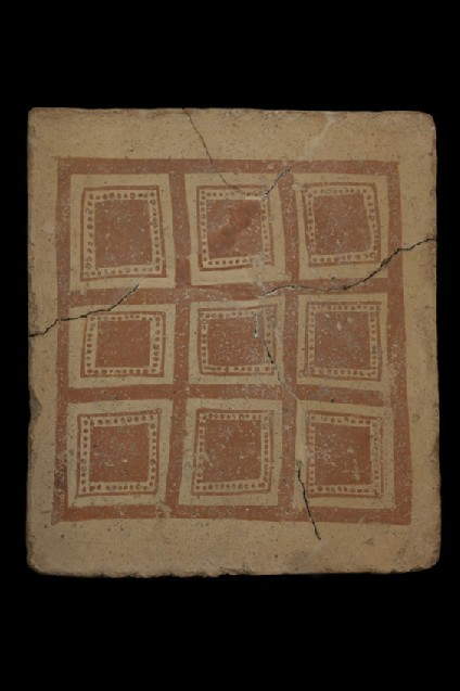 Terracotta tile with painted geometric design of square divided into nine regularly arranged smaller squares
