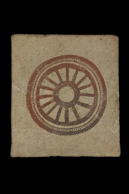 Painted terracotta tile with painted design of 14 spoked wheel