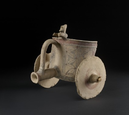 Bichrome terracotta figurine of a model of a chariot with driver