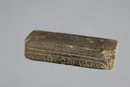 Oculist's stamp of limestone, inscribed MAVRI COLLYRVVM (Marcus's salve)