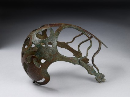 Bronze horse muzzle with engraved serpents and added bronze snakes