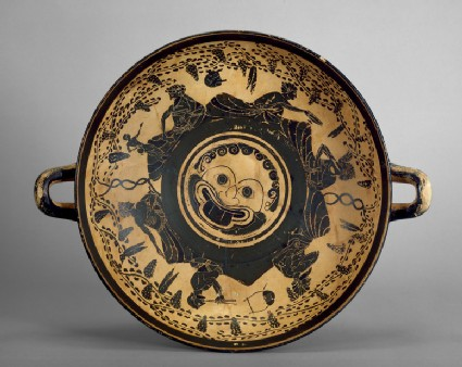 Attic black-figure pottery stemmed cup depicting a symposiastic scene
