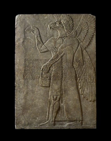 Relief of winged genius with cuneiform inscription of Ashur-nasir-pal II
