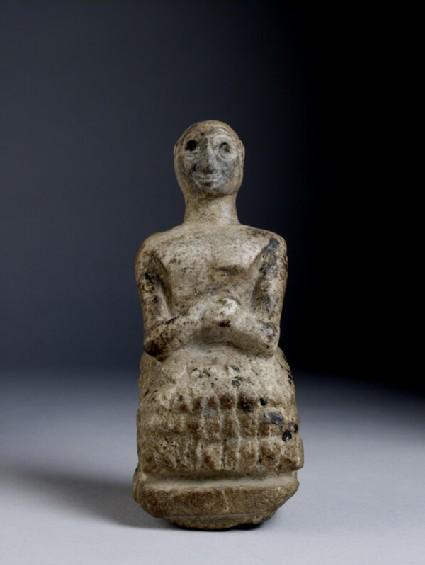 Figurine of seated man