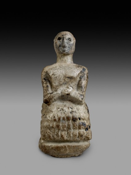 Figurine of seated man