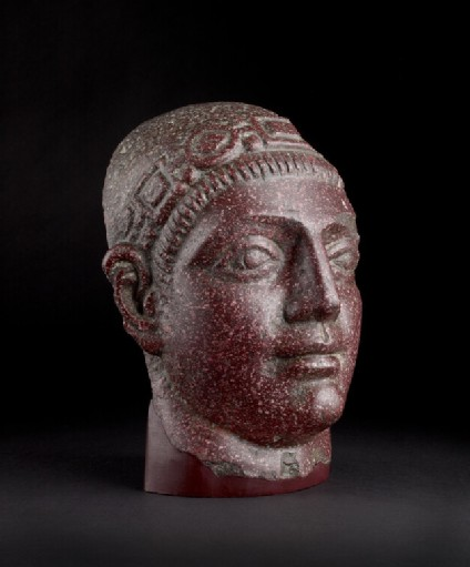 Fragmentary porphyry head of a man wearing the diadem denoting an Augustus