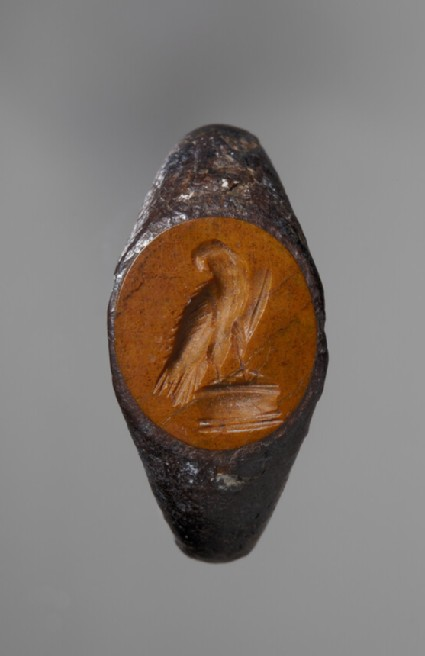 Intaglio gem set in an iron ring, eagle perching on an altar