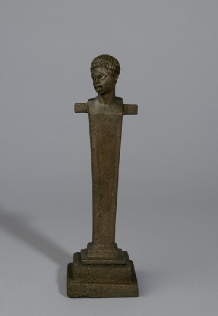 Herm or terminal with the head of a negro, silver eyes, on base with two square steps