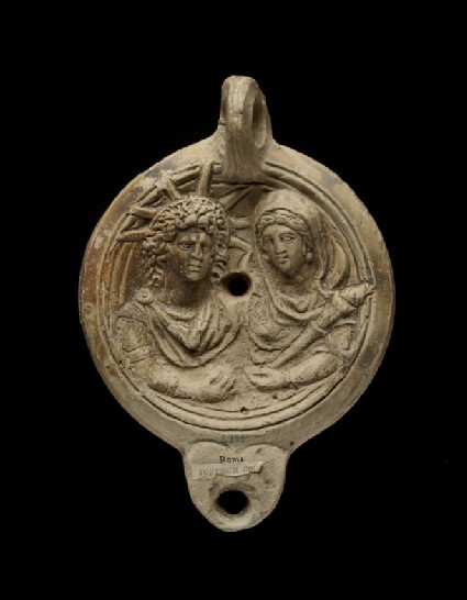 Oil lamp with depiction of Sol and Luna stamped SAECVL