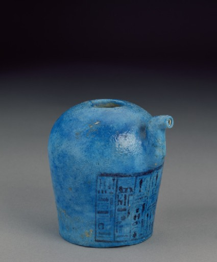 Spouted faience vessel with inscription