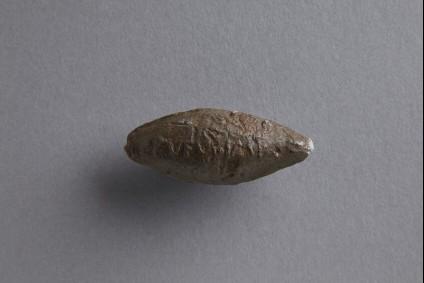 Sling bullet with thunderbolt motif inscribed RVFVS IMP