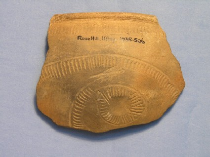 Rim sherd of burnished bowl with spiraliform decoration
