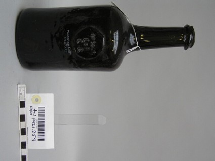 Glass wine bottle with stamp of All Souls College Common Room