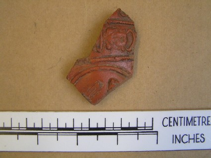 Bowl sherd with medallion and mask