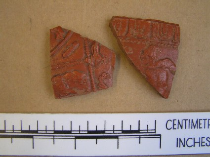 Sherds of a samian bowl decorated with a figure of Bacchus