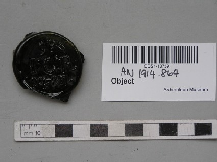 Glass bottle seal stamped with St JCR Oxon
