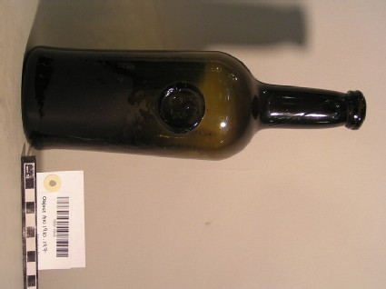 Wine bottle bearing stamp of Jesus College Common room H