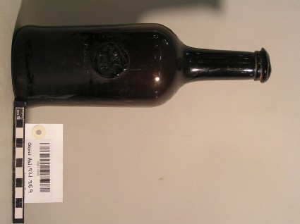 Glass wine bottle with stamp of Magdalen College Common Room