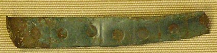 Piece of bracelet with punched decoration