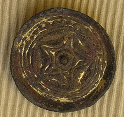 Saucer brooch with five-pointed star design