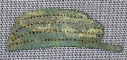Fragment of thin decorated bronze sheet