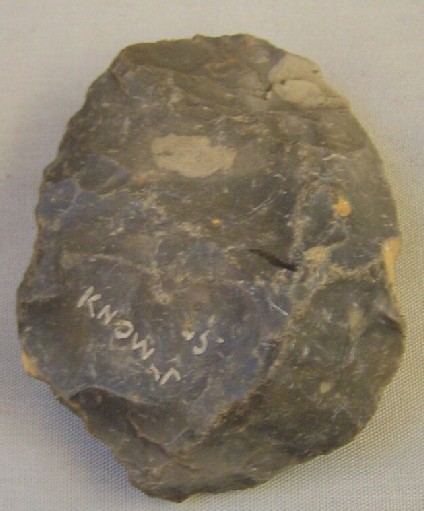 Crude handaxe fragment, heavily rolled, tip missing