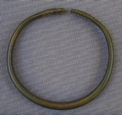 Bracelet with flattened ends decorated with incised lines and dots