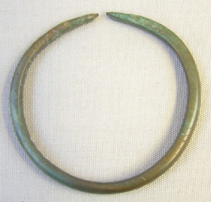 Bracelet with flat snake's head ends and incised decoration on upper and lower faces