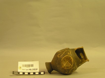Beaker of barbotine ware decorated with wheel and S design