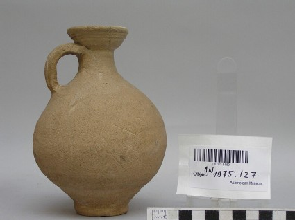 Buff pottery flagon