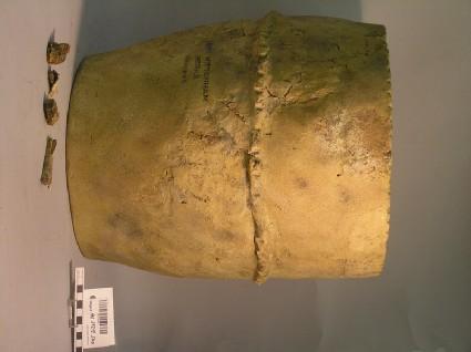 Burial urn, buff ware, cracked, band on shoulder, finger impressed