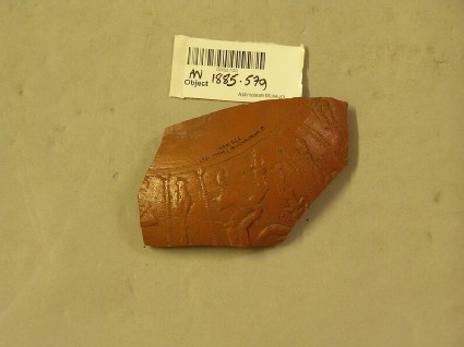 Fragment of Samian ware bowl decorated with nude figures between lines