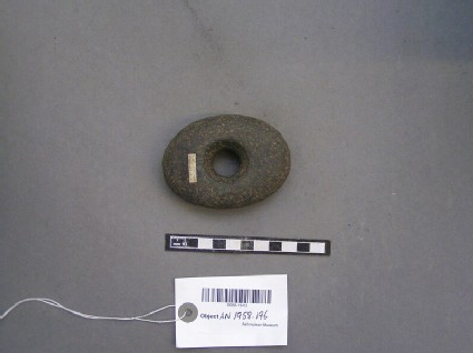 Pebble hammer with cental perforation