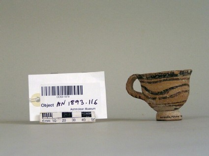 Footed cup decorated with painted wavy lines