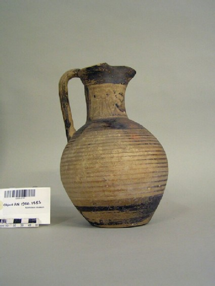 Geometric Attic trefoil mouthed oinochoe decorated with painted tripods and shields