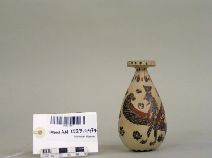 Corinthian perfume vessel (alabastron) depicting a male bearded sphinx with polos and lion among rosettes