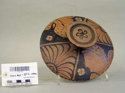Lid of a red-figure lekane decorated with Persian heads and palmettes