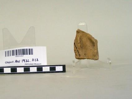 Fragment of figure in relief