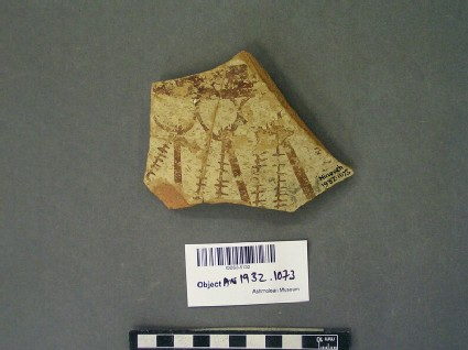 Fragment of red pottery with white slip, antelopes in red paint