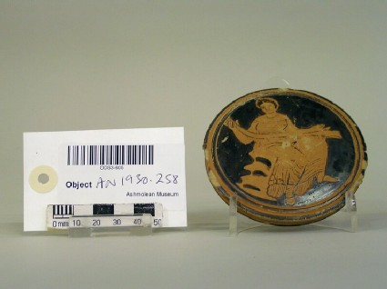 Red-figure pyxis lid decorated with woman sitting on rock