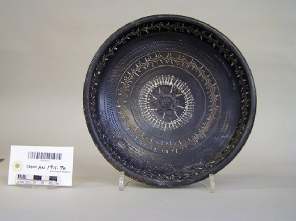 Black gloss dish with impressed and painted decoration