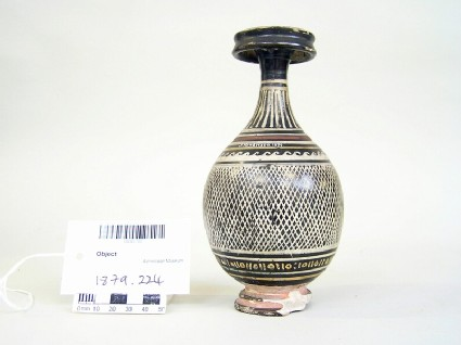 Black gloss bottle decorated with red and white bands and net pattern