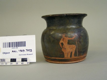Attic red-figure pottery cup depicting an elderly male figure