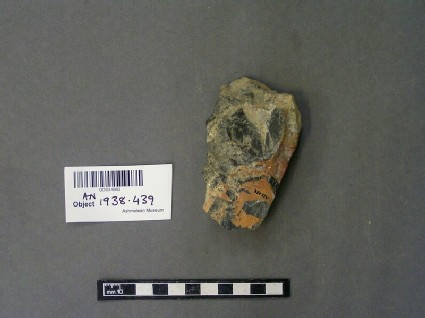 Fragment of stone with saw marks