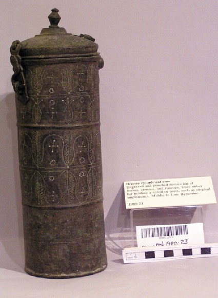 Scroll case decorated with leaves, crosses and rosettes