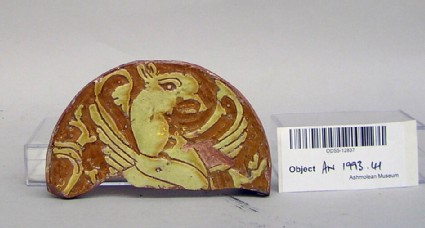 Dish fragment, decorated with griffin