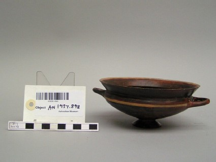 Ionian cup, black glazed, from several