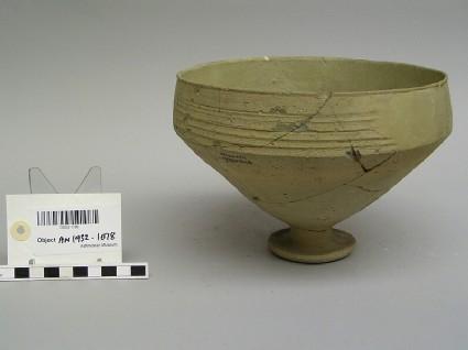 Pedestal bowl, greenish ware with horizontal grooving on rim