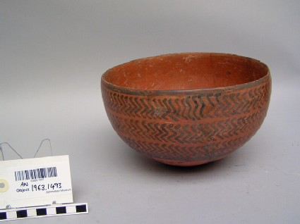 Red burnished ware bowl decorated with black paint