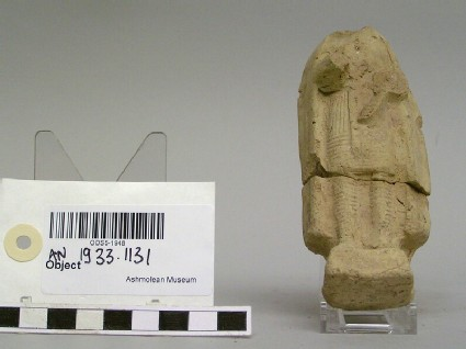 Fragmentary figurine of a man wearing trousers